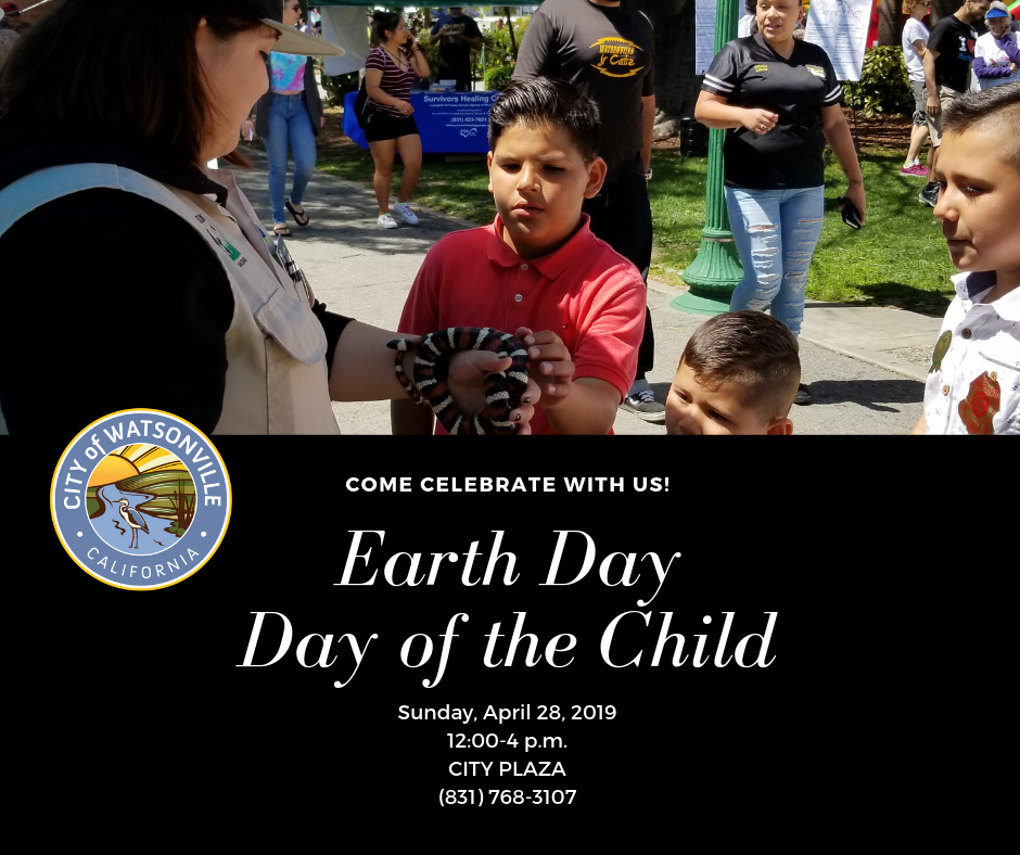 Boy holding a snake at Earth Day/Day of the Child event 2018