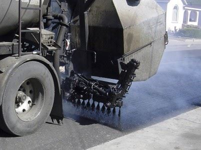 Machine Applying Surface Treatment to Street