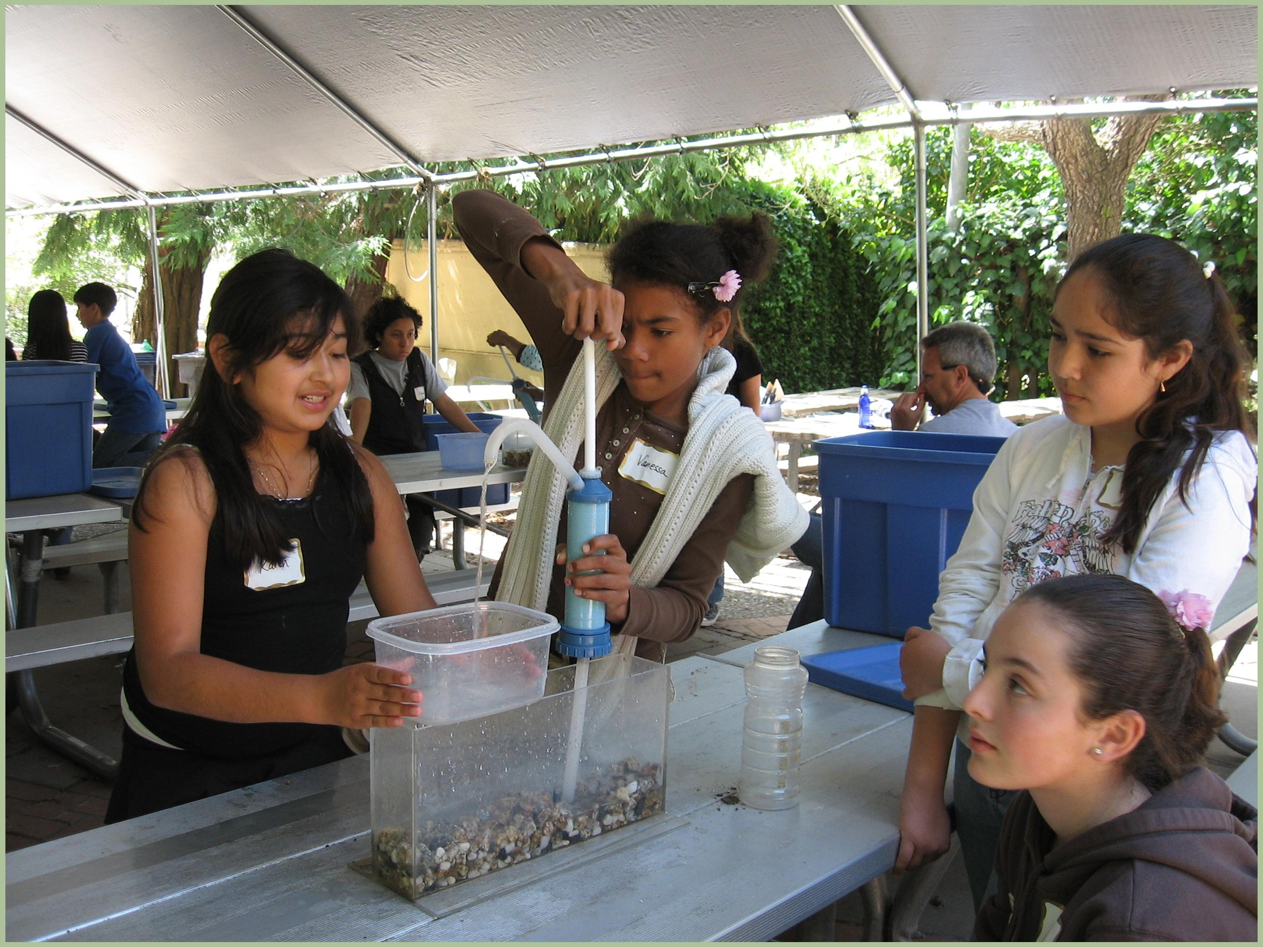 Students experimenting with water