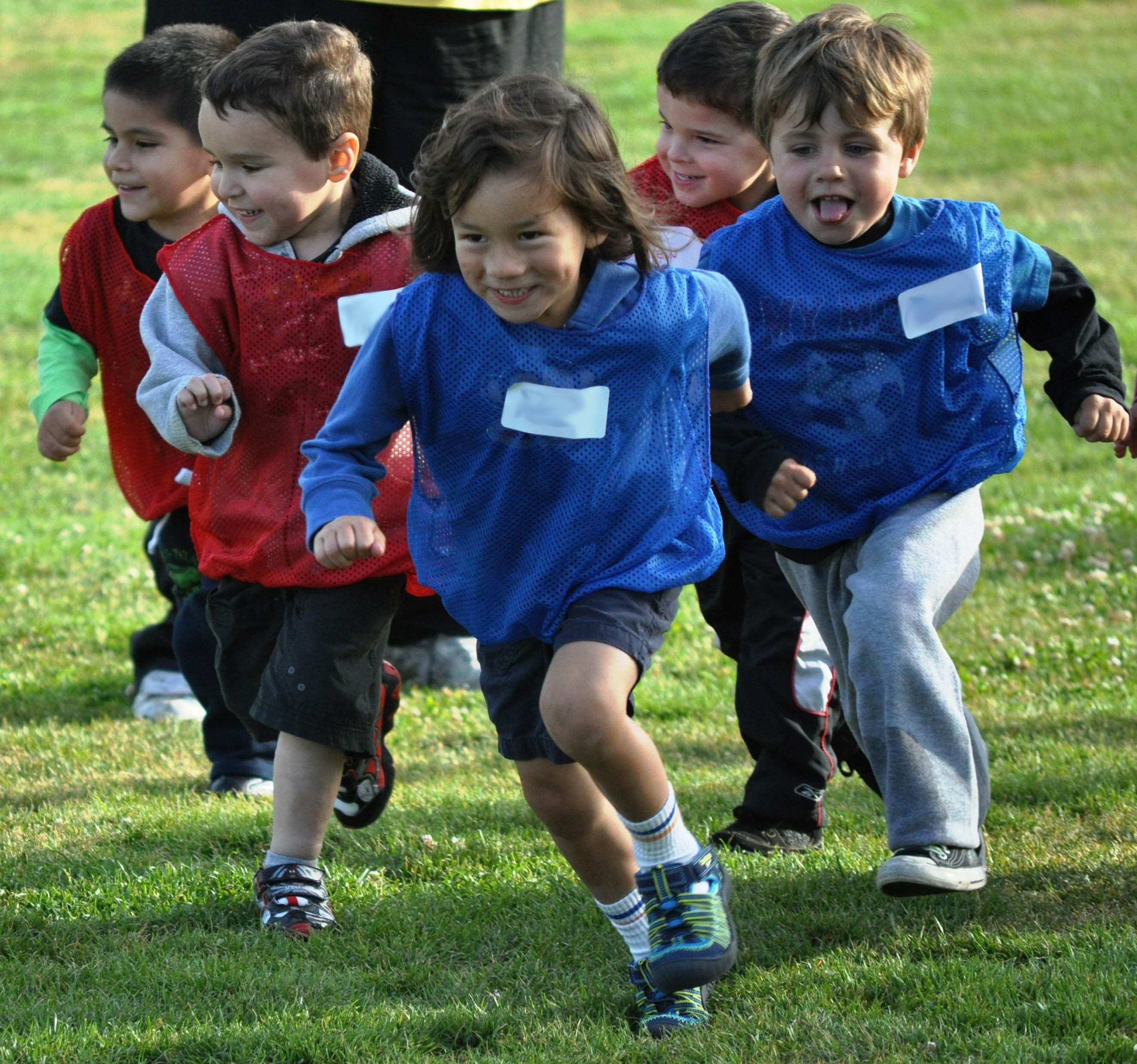 Itty Bitty youth soccer participants running during a game