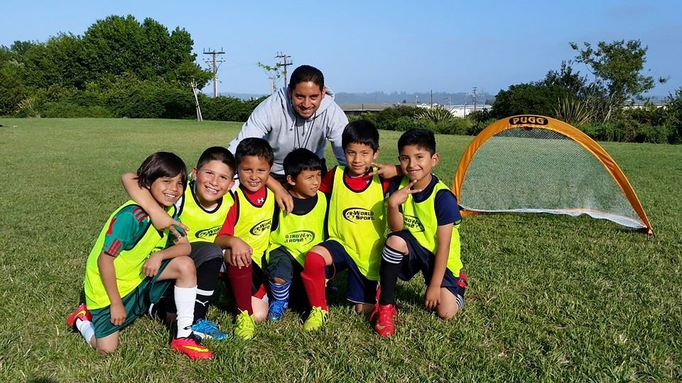Soccer coach with his youth participants