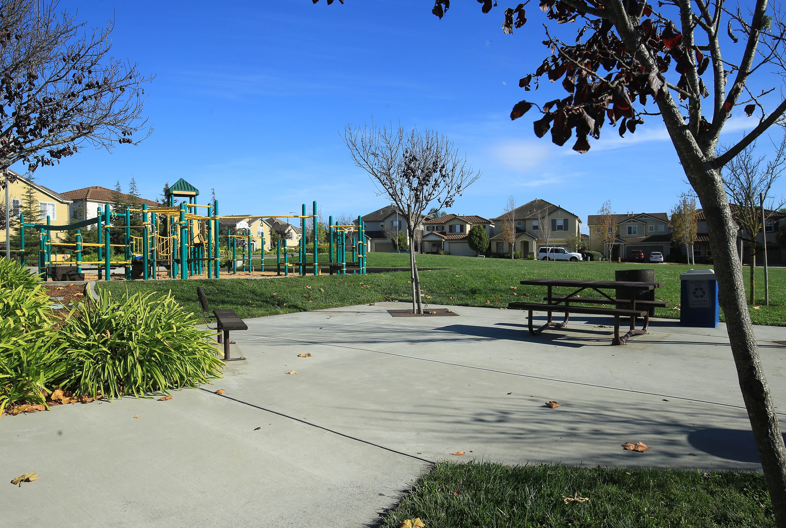 Concrete patio and playground structure at Las Brisas park