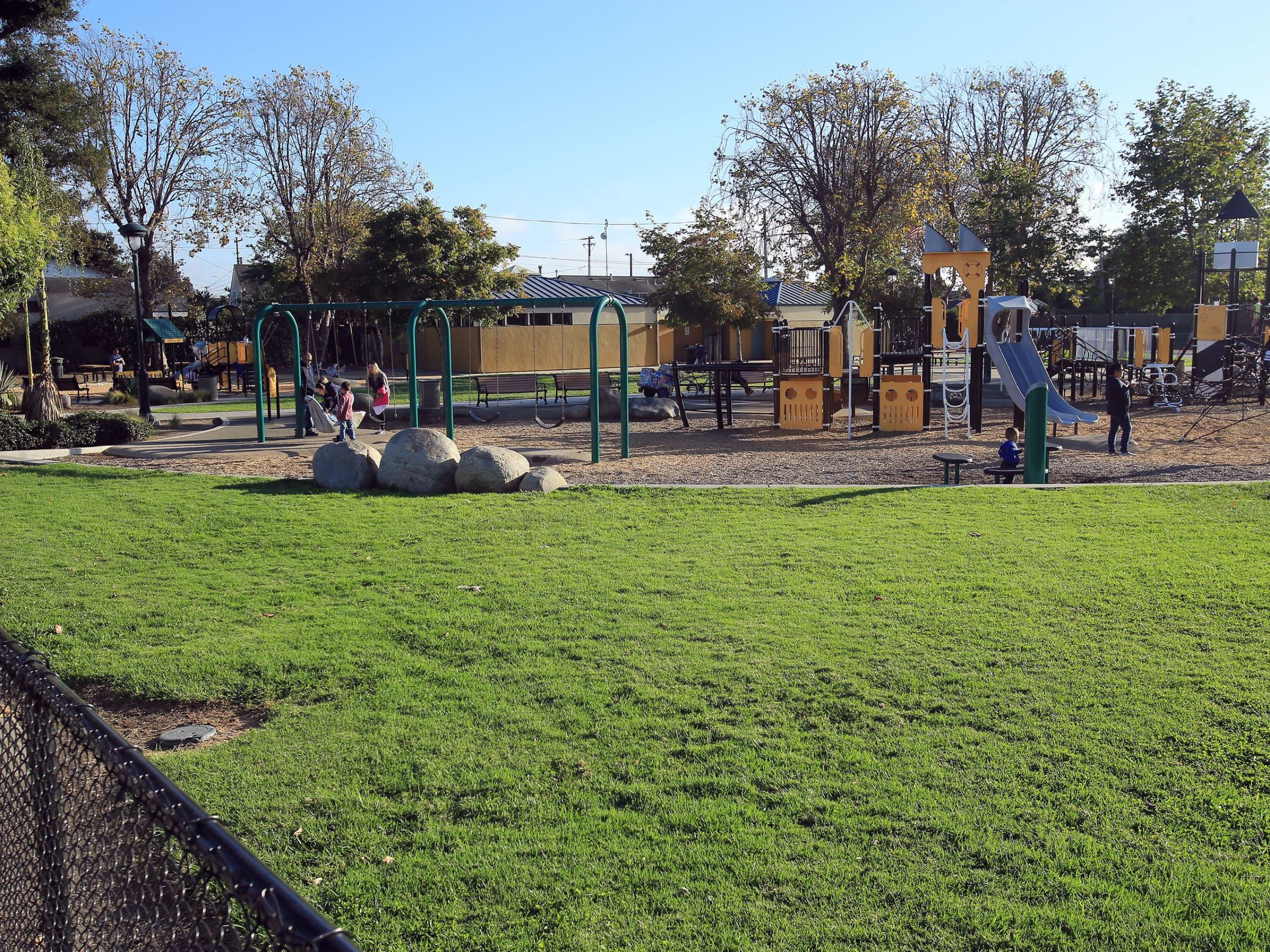 Callaghan park green space next to playground area