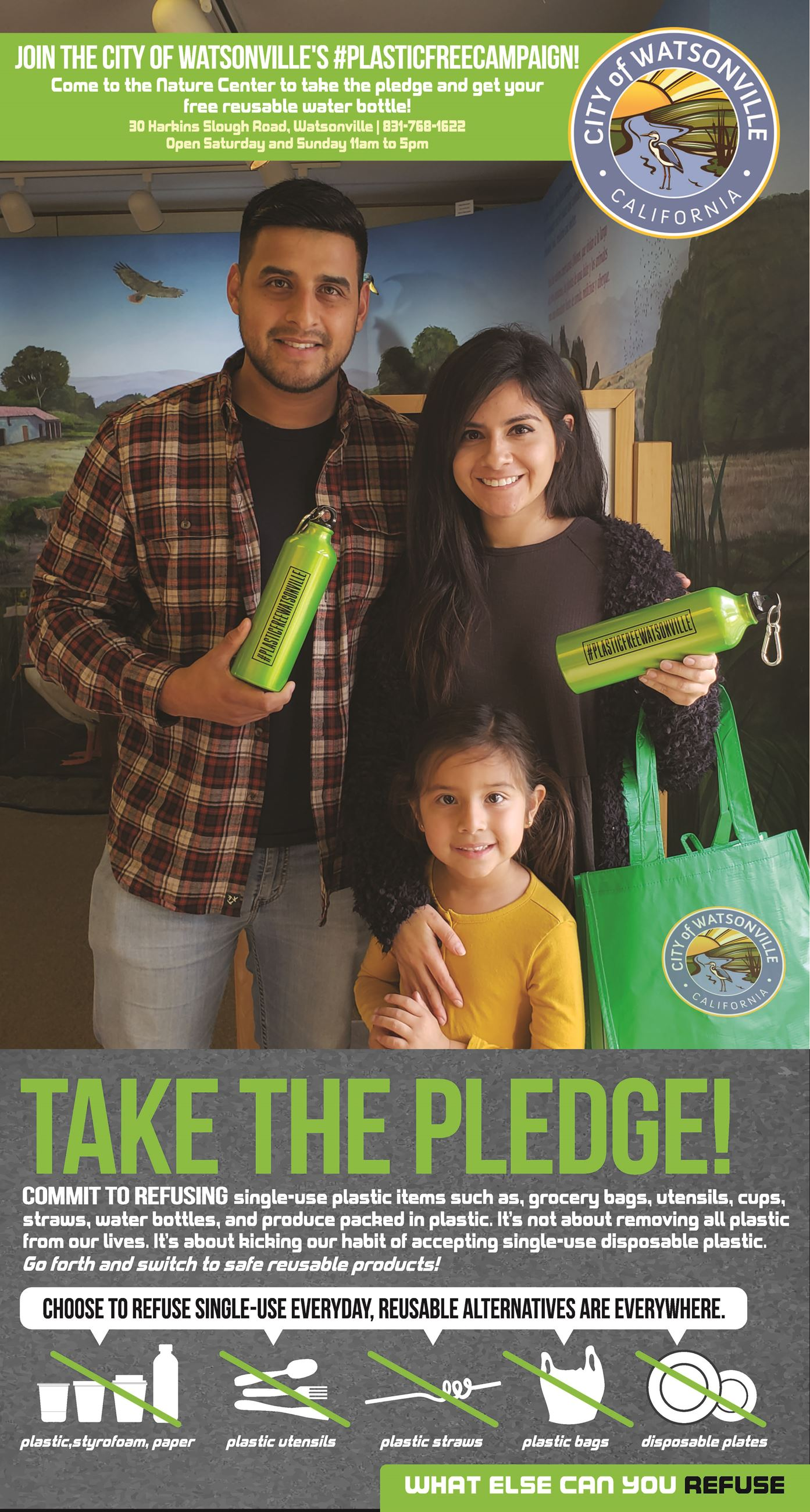 Family who took the pledge and are holding reusable water bottles
