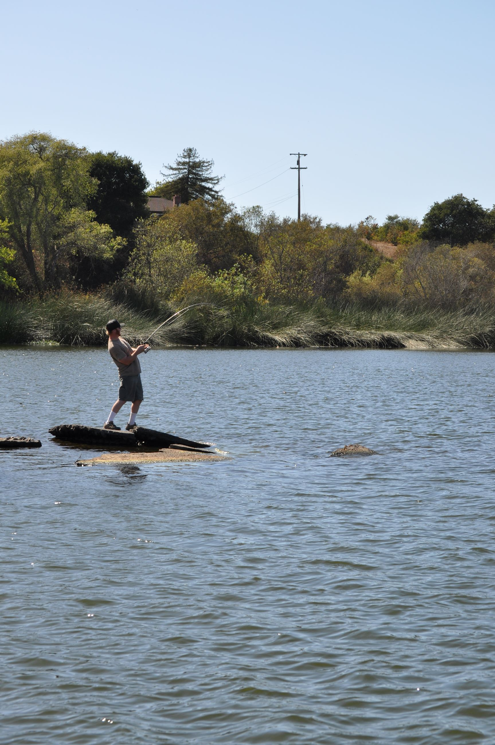 Person catching a fish in Pinto Lake