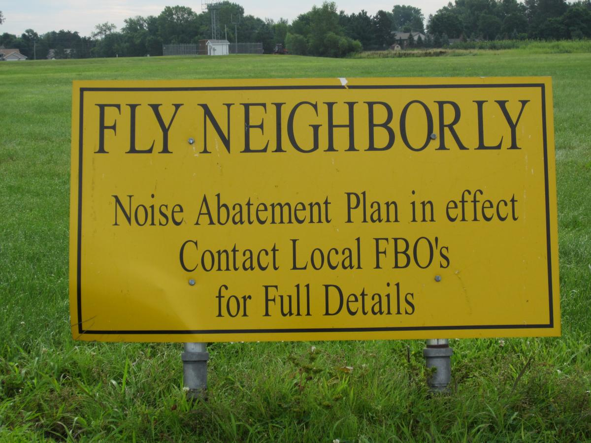 Fly Neighborly, Noise Abatement Plan in Effect, Contact Local FBOs for Full Details Sign