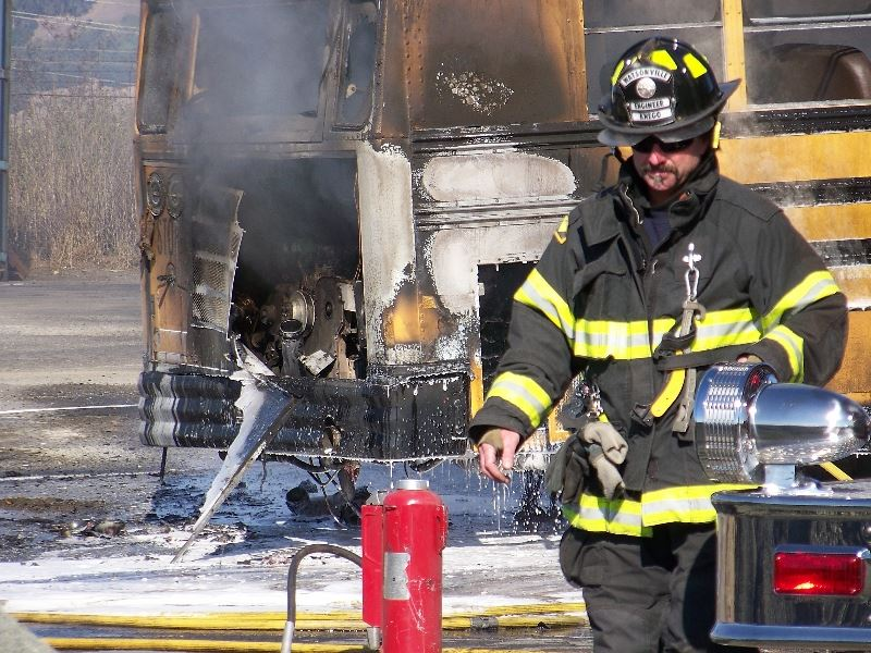 Firefighter and burning school bus
